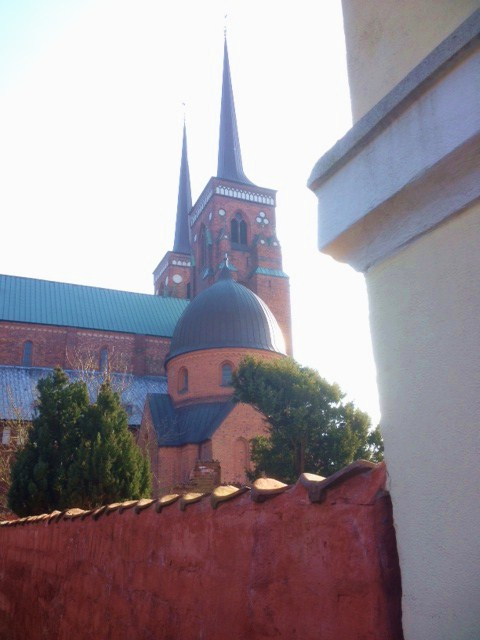 Roskilde cathedral in late afternoon set in red colors