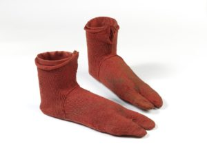 very ancient pair of red socks excavated in Egypt
