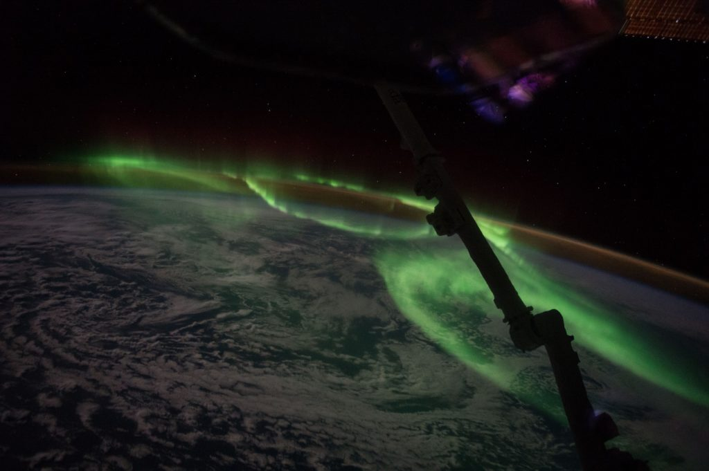 Brilliant lights of an aurora, seen from space.